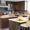 Colored kitchen with brown cabinets will create a harmonized nuance to the surrounding